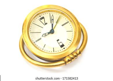 Vintage golden alarm clock isolated on white