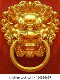 Vintage golden dragon door knocker.
