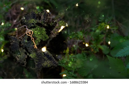 vintage golden key on magical forest background. concept secret garden. mystery art background. copy space.