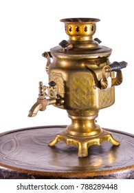 Vintage gold-plated samovar on a wooden table