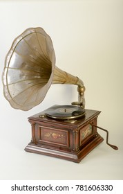 Vintage gramophone with horn speaker isolated on white