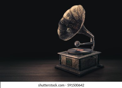vintage gramophone on a wooden background with dramatic lighting