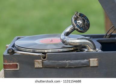 Vintage gramophone with vinyl plate in the street