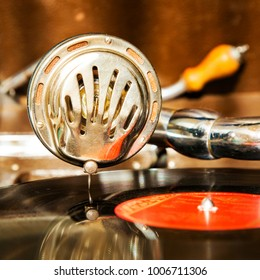 Vintage gramphone playing vynil music disck