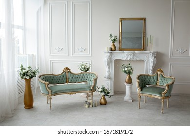 Vintage green armchairs in the interior near the fireplace - Shutterstock ID 1671819172