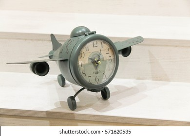 Vintage green clock-aircraft. Concept: time flies