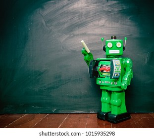 vintage green robot and a blackboard  toned image
