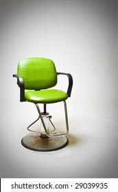 Vintage green vinyl covered barber shop chair.