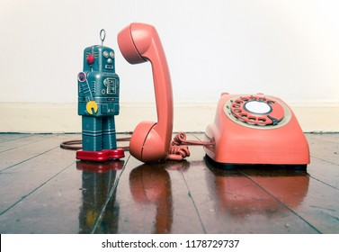vintage grey robot toy on the phone standing on a old wooden floor