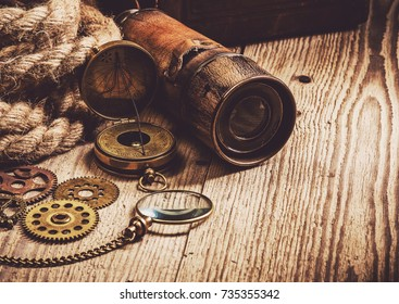 Vintage grunge still life. Antique items on wooden table. Travel geography navigation concept background.