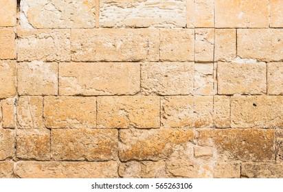 Vintage grunge stone blocks wall texture.