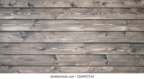 Vintage or grungy weathered shabby brown painted natural wood texture. Wooden background.