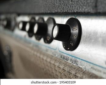 Vintage guitar amplifier closeup,focus on volume knob, for music,sound,entertainment themes