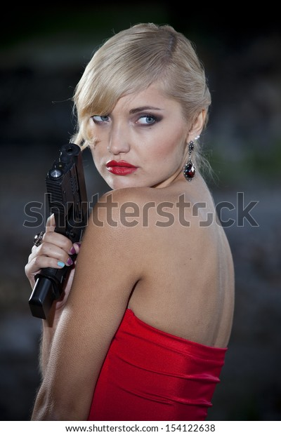 Vintage gun woman posing outdoor