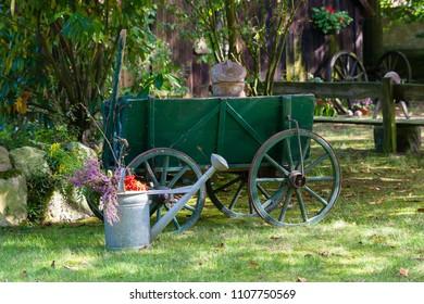 Vintage hand cart as decoration in a farm garden