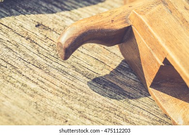 vintage hand tools on wooden background. Old jack-plane. Carpenter workplace
