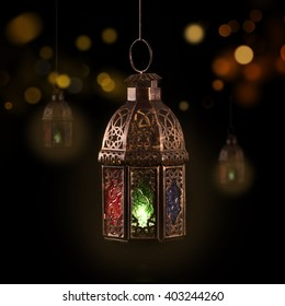 Vintage hanging lantern. Ramadan mood at night with light decoration in the background.