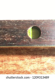 Vintage hardwood and brass level over sapele boards.