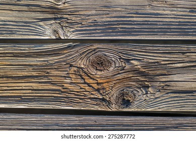 Vintage hardwood flooring is faded tones of brown and gray.