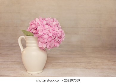 Vintage Hazy Pink Hydrangea with a rustic wood background with rom for copy.