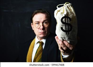 vintage head master with money bag