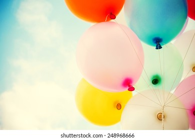 vintage heart balloon with colorful on blue sky concept of love in summer and valentine, wedding honeymoon