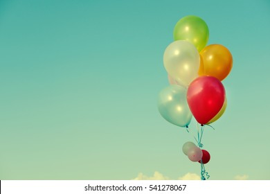 vintage heart balloon with colorful on blue sky. ceremony events