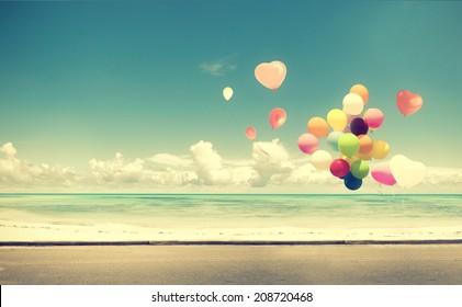 Vintage heart balloon on beach blue sky concept of love in summer and wedding honeymoon