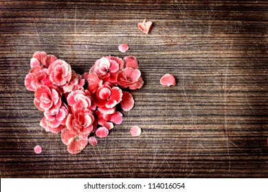vintage heart from flowers   on wooden table/vintage valentin day background