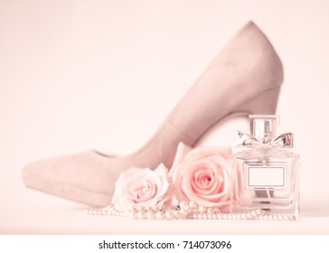 Vintage heel shoes, roses and perfume bottle