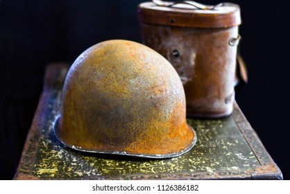 vintage helmet and canteen from WW1, on display at a military event