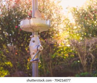 Vintage hills hoist clothes line with peg basket in garden with golden bokeh