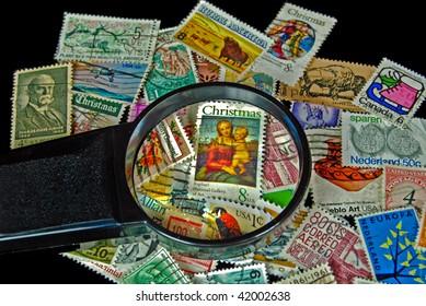 vintage holiday stamp under magnifier