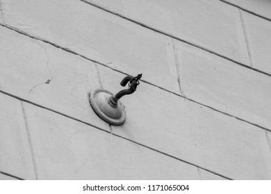 Vintage hook in the wall for fixing cables