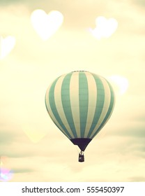 Vintage hot air balloons with bokeh hearts