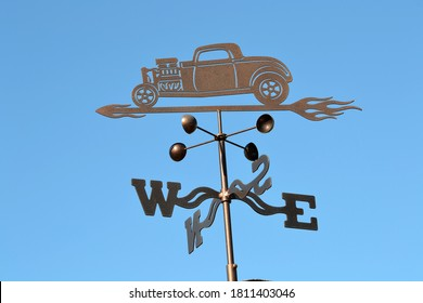 A vintage hot rod weathervane.