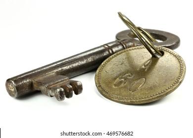 vintage hotel key isolated on white background