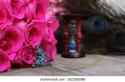 Vintage Hourglass With Pink Roses and Peacock Feathers