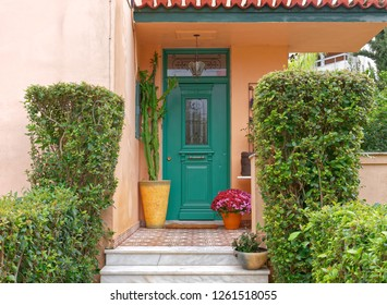 vintage house entrance green door and flowerpots, Athens Greece
