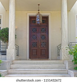 vintage house luxurious entrance with marble stairs and wooden door