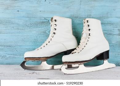 Vintage ice skates for figure skating on turquoise background