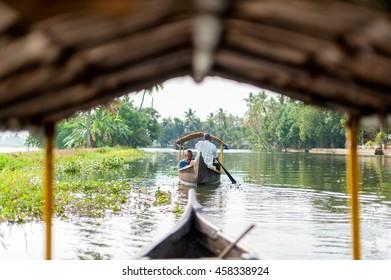 Vintage  image of Kerala backwaters tourism travel in canoe. Kerala, India