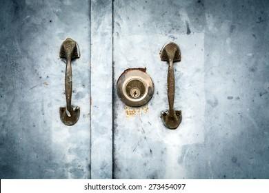Vintage image of key hole and door handle on grunge door