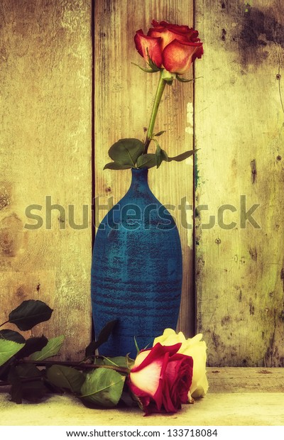 Vintage image of roses on a rustic wooden background