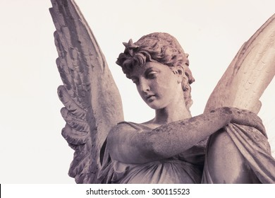 Vintage image of sad angel on a cemetery against the white background (details)