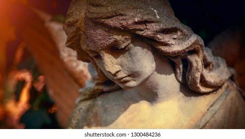 Vintage image of a sad angel. Retro stylized. faith, religion, Christianity, death, immortality concept