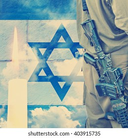 Vintage image.Soldier of Israeli defense forces on Israeli national flag wall and sky background with burning candle
