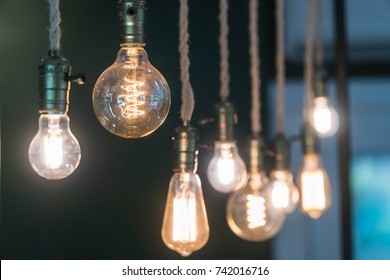 Vintage incandescent Edison type bulbs and window reflections.