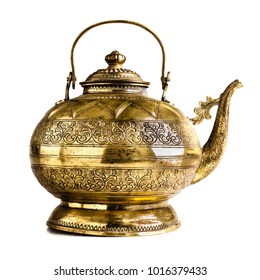a vintage Indian or philippine teapot isolated on a white background