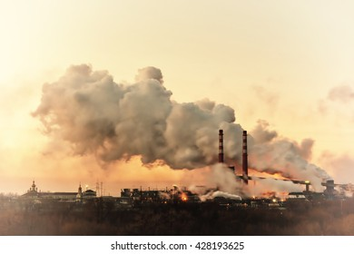 Vintage industrial landscape with chemical factory, pipes and smoke, long exposure